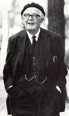 A photograph depicts Jean Piaget in his later years.