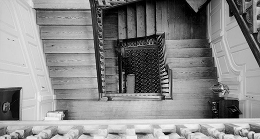 A photograph shows the view down the stairway from the third floor of Westover Plantation.