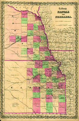 A historic map shows the territories of Kansas and Nebraska in 1855, as well as proposed routes of the transcontinental railroad.