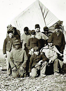 A photograph shows a small group of casually posed black and white Union soldiers.