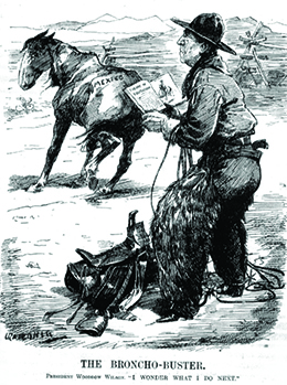 """A cartoon entitled """"The Broncho-Buster"""" depicts Woodrow Wilson dressed as a cowboy, holding a book that is open to a page headed """"Theory of Equitation."""" A saddle is at his feet. A saddleless horse wanders nearby with """"Mexico"""" printed on its rear end. The caption reads """"President Woodrow Wilson. 'I wonder what I do next.'"""""""