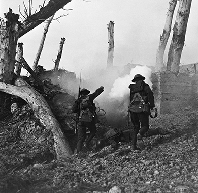 A photograph shows two U.S. soldiers running past fallen Germans on their way to a bunker.