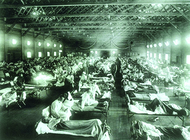 A photograph shows a massive hospital ward filled with flu victims.