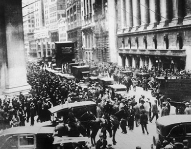 A photograph shows large crowds of people on Wall Street.