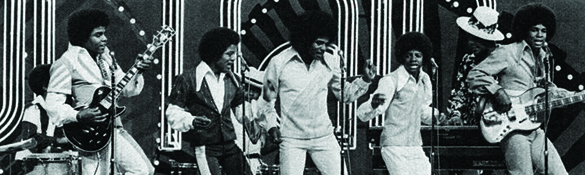 A photograph shows the Jackson Five performing. Each member of the group sports an afro hairstyle.