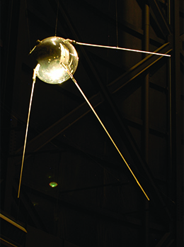 A photograph shows a replica of Sputnik.