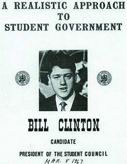 "A poster featuring a photograph of a college-age Bill Clinton reads ""A Realistic Approach to Student Government / Bill Clinton / Candidate / President of the Student Council."" Hand-lettered at the bottom is the date ""Mar. 8 1967."""
