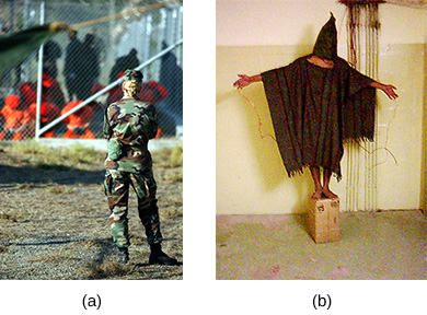 Photograph (a) shows a group of handcuffed detainees behind a fence; a uniformed soldier in the foreground stands watching them. Photograph (b) shows a man wearing a large piece of fabric, with a hood covering his face; he is being forced to balance on a small box with his arms held out to his sides.