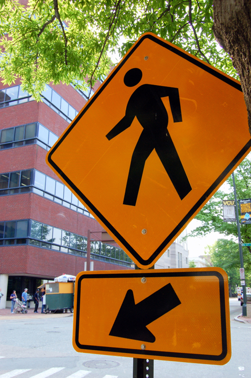 The photo (a) shows a sign of a pedestrian crossing and an arrow.