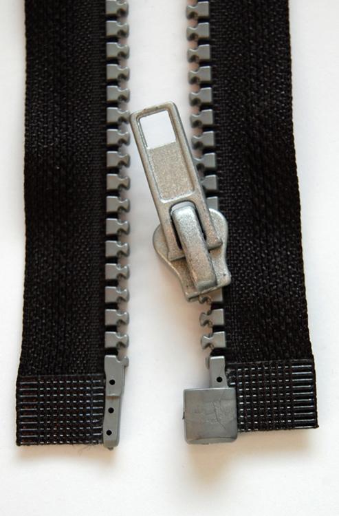 Figure (b) shows a modern zipper.