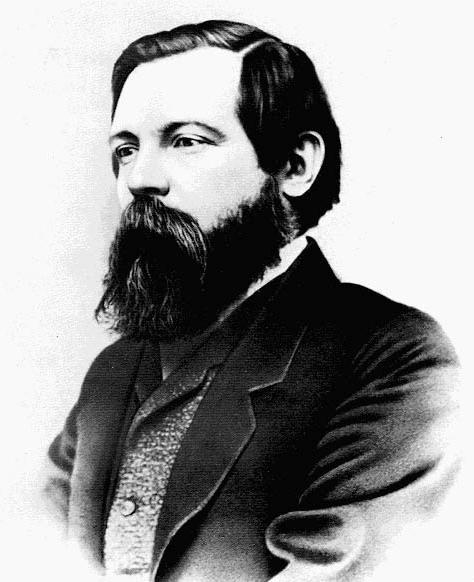 Photos of Karl Marx and Friedrich Engels.