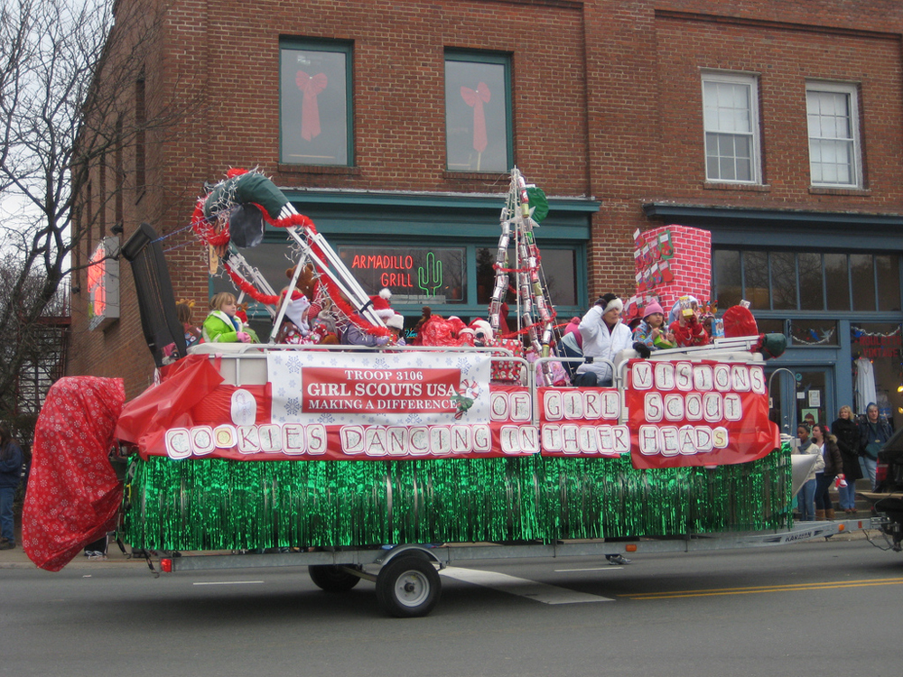Figure a shows a float made by Girl Scouts.