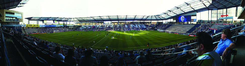 An image of the inside of a stadium. The stands are filled with people.