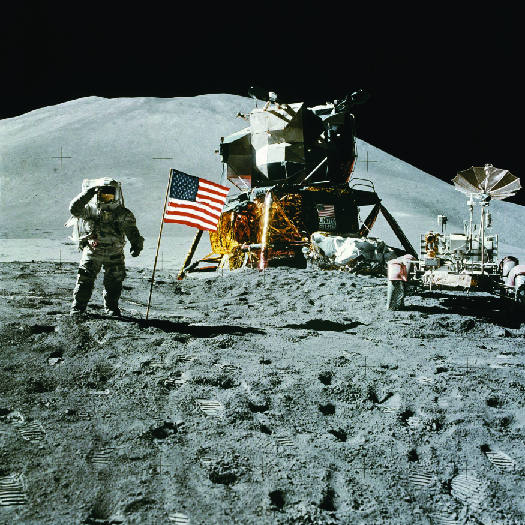 A photo of an astronaut on the moon standing next to the American flag.