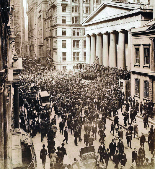 An image of a large crowd of people filling Wall Street.