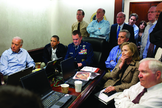 An image of Barack Obama, Joe Biden, Hillary Clinton, Robert Gates, and other national security advisors in the White House Situation Room.