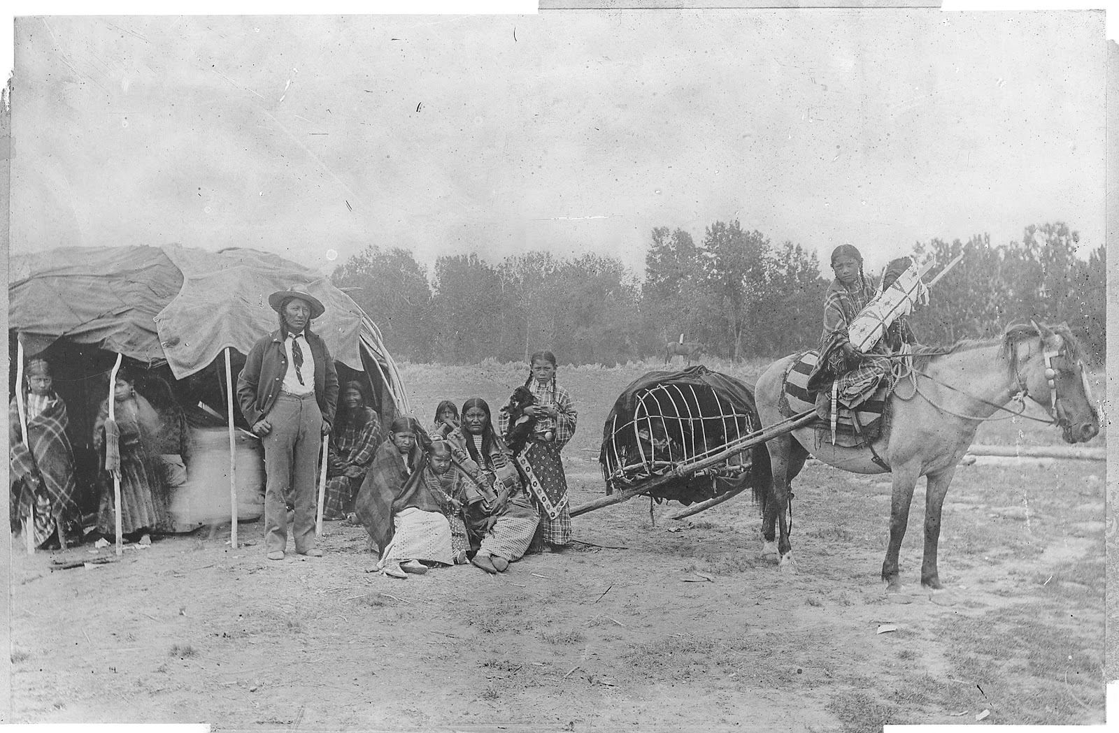 """""""Cheyenne: Stump Horn and family showing Horse Travois."""" Author unknown (U.S. National Archives and Records Administration) [Public domain], via Wikimedia Commons"""