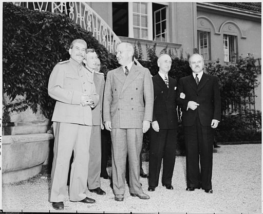 President Truman and Soviet Union Prime Minister Josef Stalin on the lawn in front of Prime Minister Stalin's residence during the Potsdam Conference, Potsdam, Germany. L to R: Prime Minister Josef Stalin, V. N. Pavlov, interpreter for Prime Minister Stalin, President Harry S. Truman, Secretary of State James Byrnes, and Soviet foreign minister Vyacheslav Molotov.