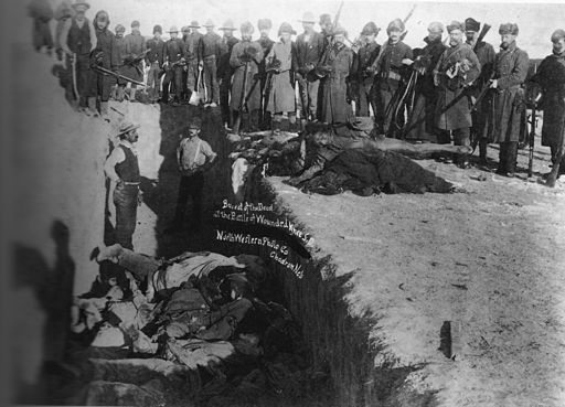 Mass grave for the dead Lakota after the conflict at Wounded Knee Creek.  By Northwestern Photo Co. [Public domain], via Wikimedia Commons