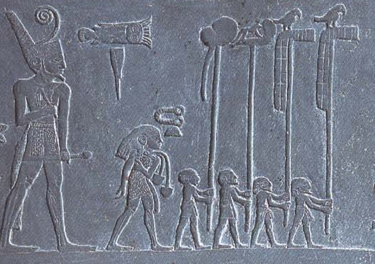 "Close- up of the left side of the Palette of Narmer. Note the larger figure of King Narmer, with celebratory flag bearers preceding him. | Author: User ""NebMaatRa"" 