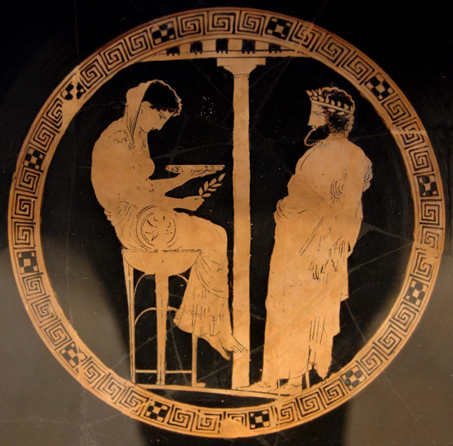 "Themis and Aegeus | The Pythia seated on the tripod and holding a laurel branch– symbols of Apollo, who was the source of her prophecies. This is the only surviving image of the Pythia from ancient Greece | Author: User ""Bibi Saint-Poi"" 