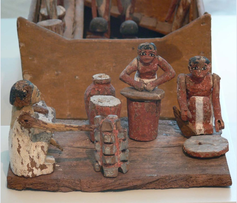 Female figurines from ancient Egypt | These  figurines show some of the everyday tasks carried out by women. They made bread, brewed beer, and prepared for family meals. | Author: Andreas Praefcke | Source: Wikimedia Commons | License: Public Domain