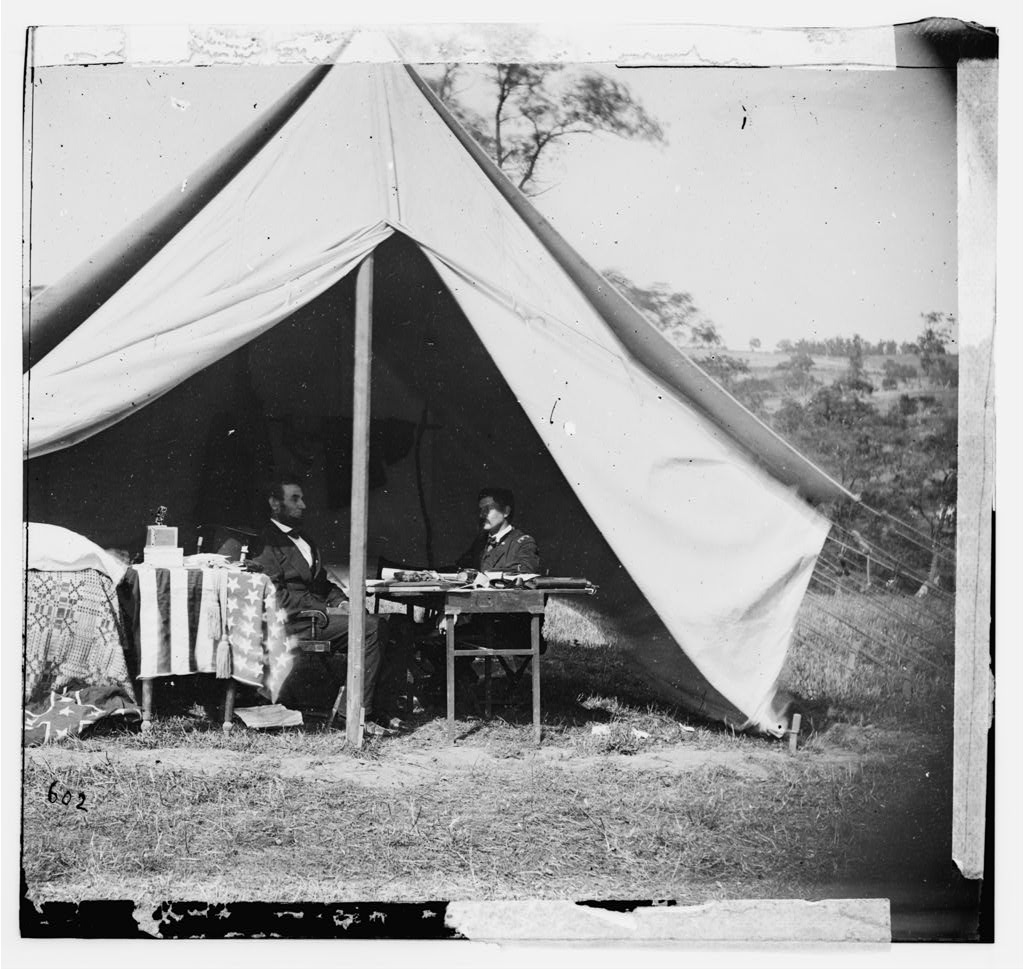 """""""Antietam, Md. President Lincoln and Gen. George B. McClellan in the general's tent; another view,"""" (cropped) by Alexander Gardner, [Public domain], via Library of Congress."""