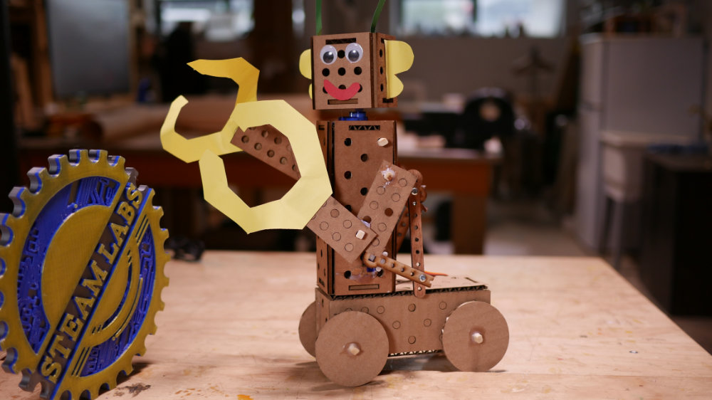A robot made with the cardboard construction parts.