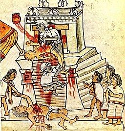 Aztec ritual human sacrifice portrayed in the page 141 (folio 70r) of the Codex Magliabechiano. [Public domain], via Wikimedia Commons