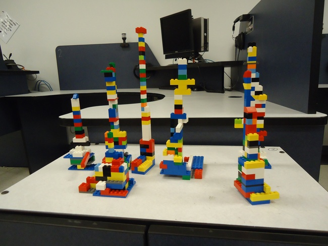 Towers of LEGO bricks made by students as part of teamwork activity.
